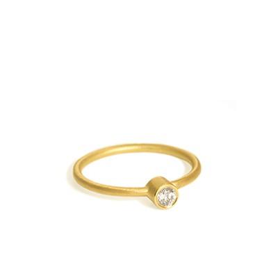 Bague en or 18 carats ornée d'un diamant 0,10 carat